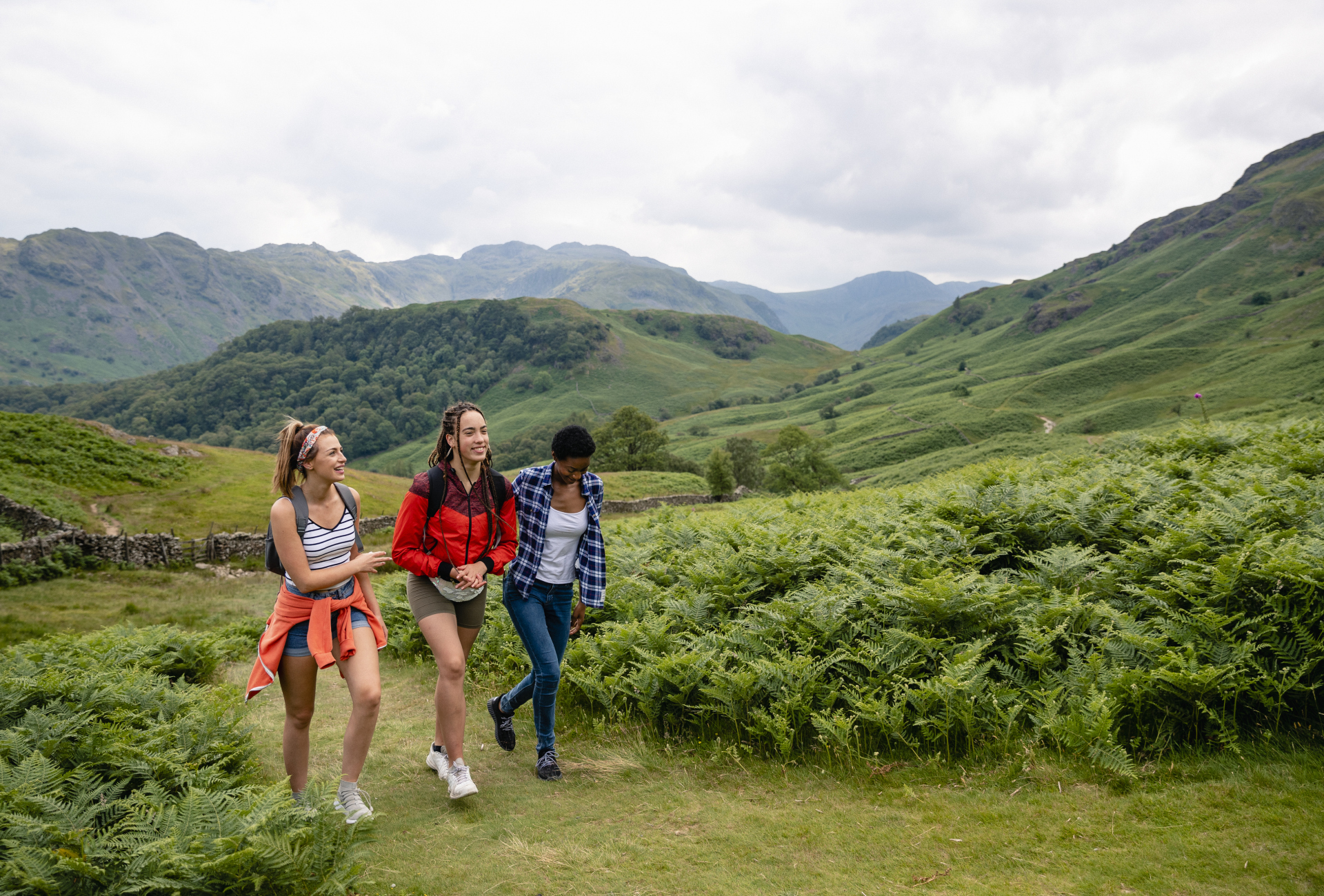 Girls walking in Lake District - istock